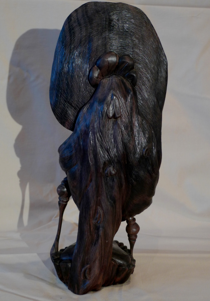 Бюст из черного дерева